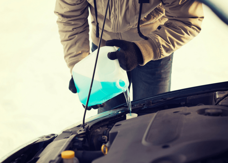 Man Pouring Antifreeze Into Car