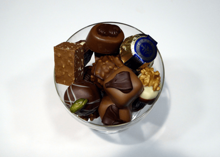 Bowl Of Chocolates On White Background