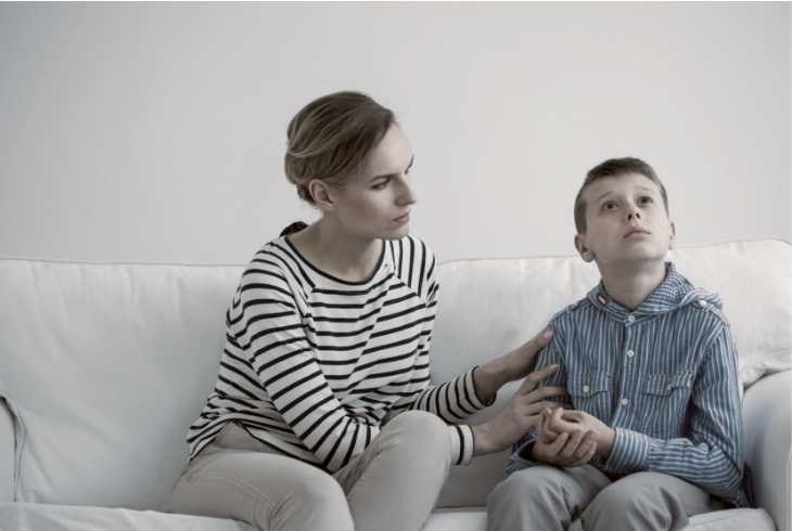 Mother sitting on the couch with her autism child