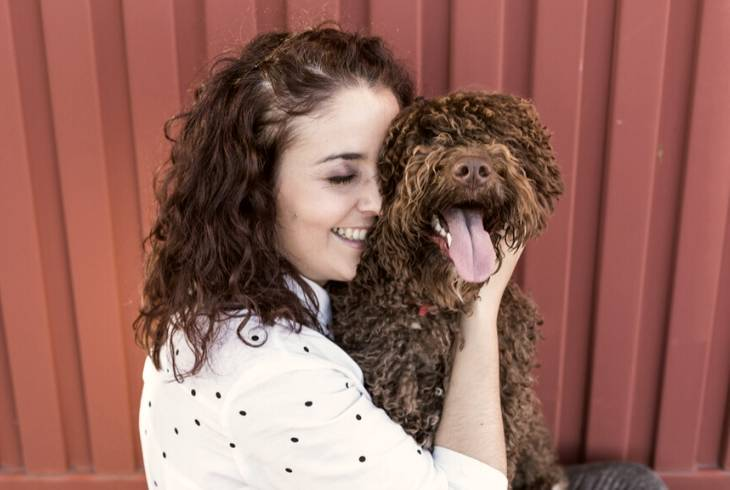 Girl adopting an American water spaniel dog