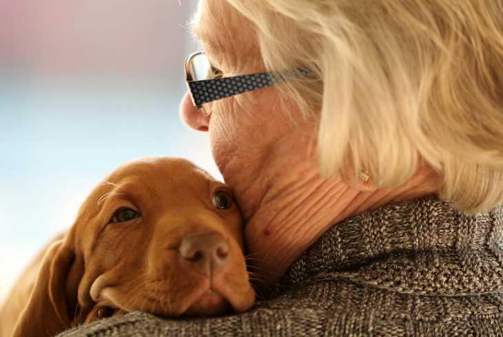 Senior lady bonding with her puppy