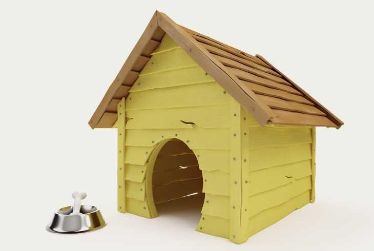 Yellow dog house on grey background