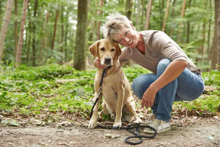Woman with Labrador Retriever