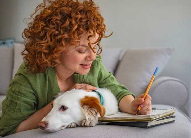 Woman writing with her dog