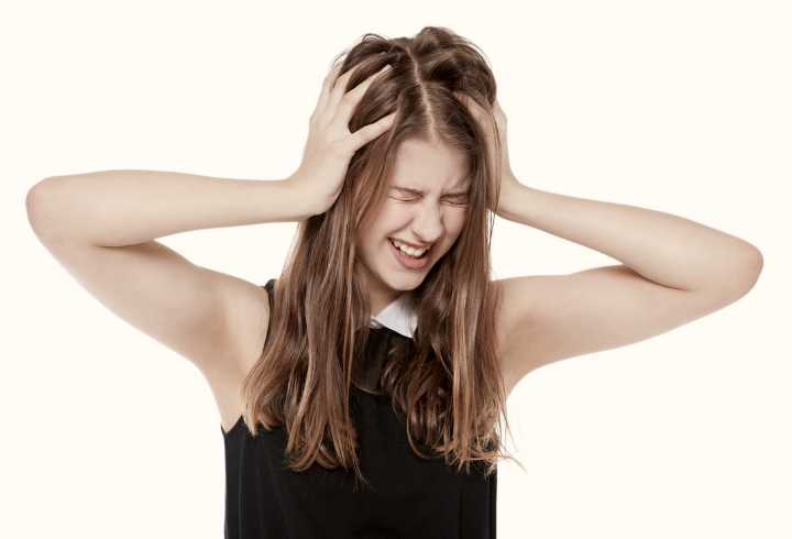 Woman with migraine on white background